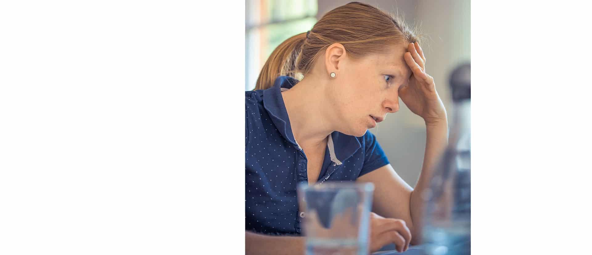 Frustrated woman mental roadblock